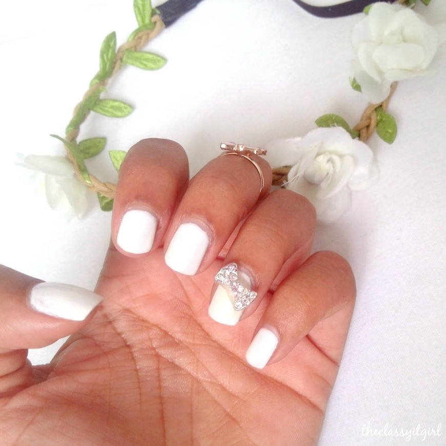 At that same mall, I had my first shellac mani and of course, I had to choose white nail polish and add a little bow